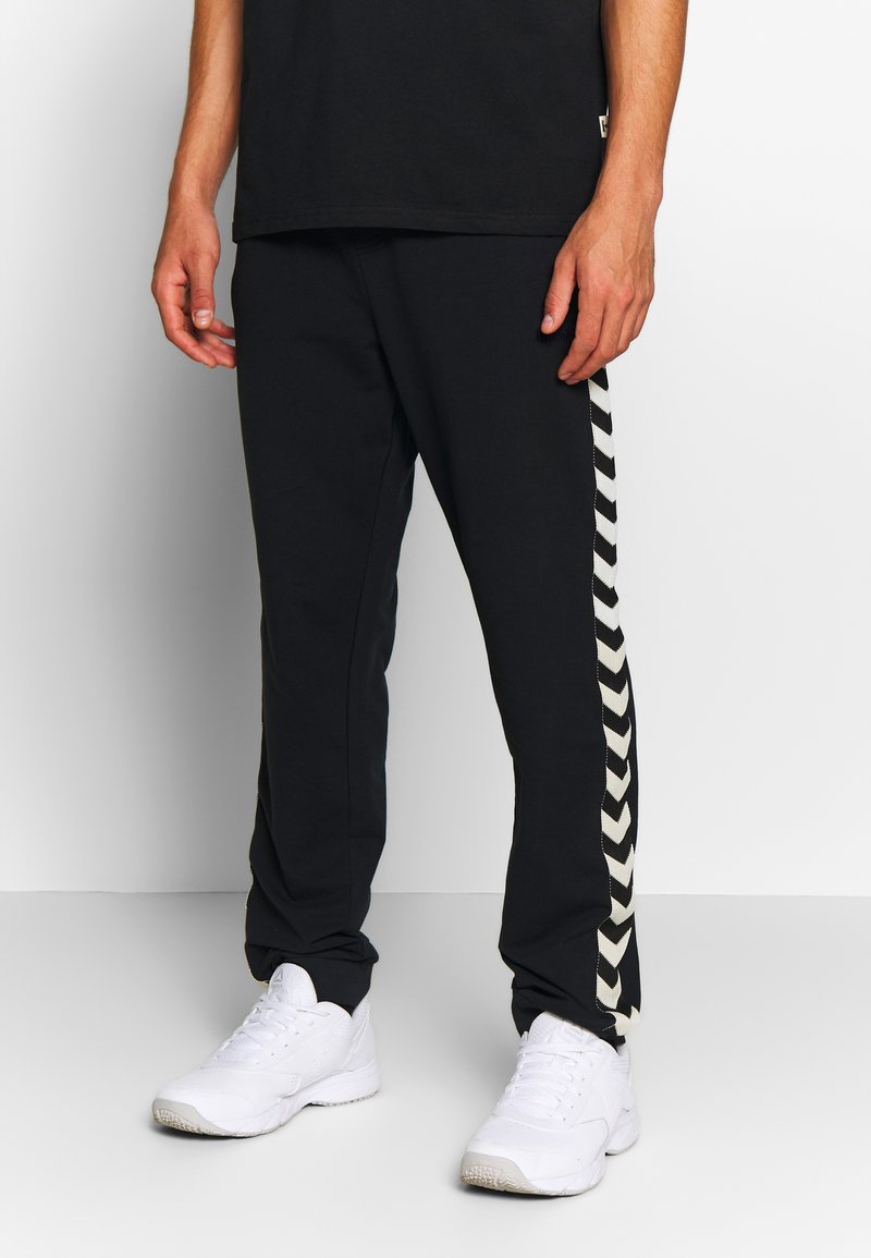 Hummel - MOVE CLASSIC PANTS - Tracksuit bottoms - black