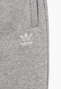 adidas Originals - UNISEX - Tracksuit bottoms - medium grey heather/white - 2