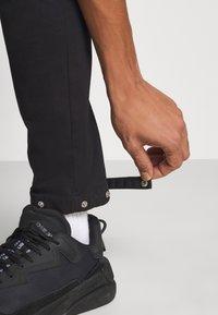 Night Addict - NAASTRID - Cargo trousers - black - 4