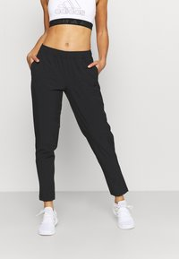 adidas Performance - TRAIN PANT - Tracksuit bottoms - black - 0