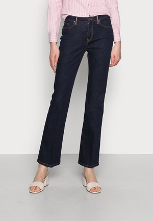 CHRISSY - Flared Jeans - denim