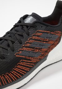 adidas Performance - SOLAR BOOST ST 19 - Stabilty running shoes - core black/grey five/solar orange - 5