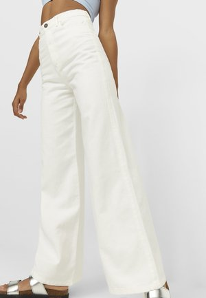 Jeansy Bootcut - white