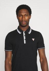 Guess - SCOTT - Polo shirt - jet black - 4