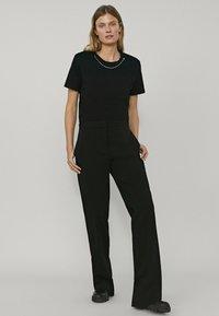 Massimo Dutti - MIT SCHLAG - Pantalon classique - black - 1