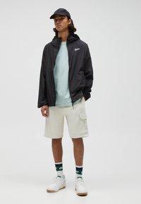 PULL&BEAR - Waterproof jacket - black - 1