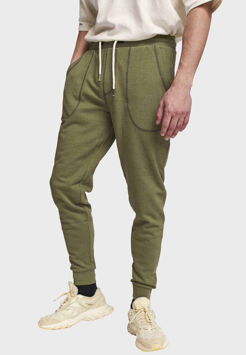 Redefined Rebel - DIEGO - Tracksuit bottoms - loden green