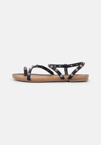SARA - T-bar sandals - black