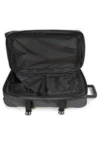 Eastpak - TRANVERZ - Wheeled suitcase - black denim - 6