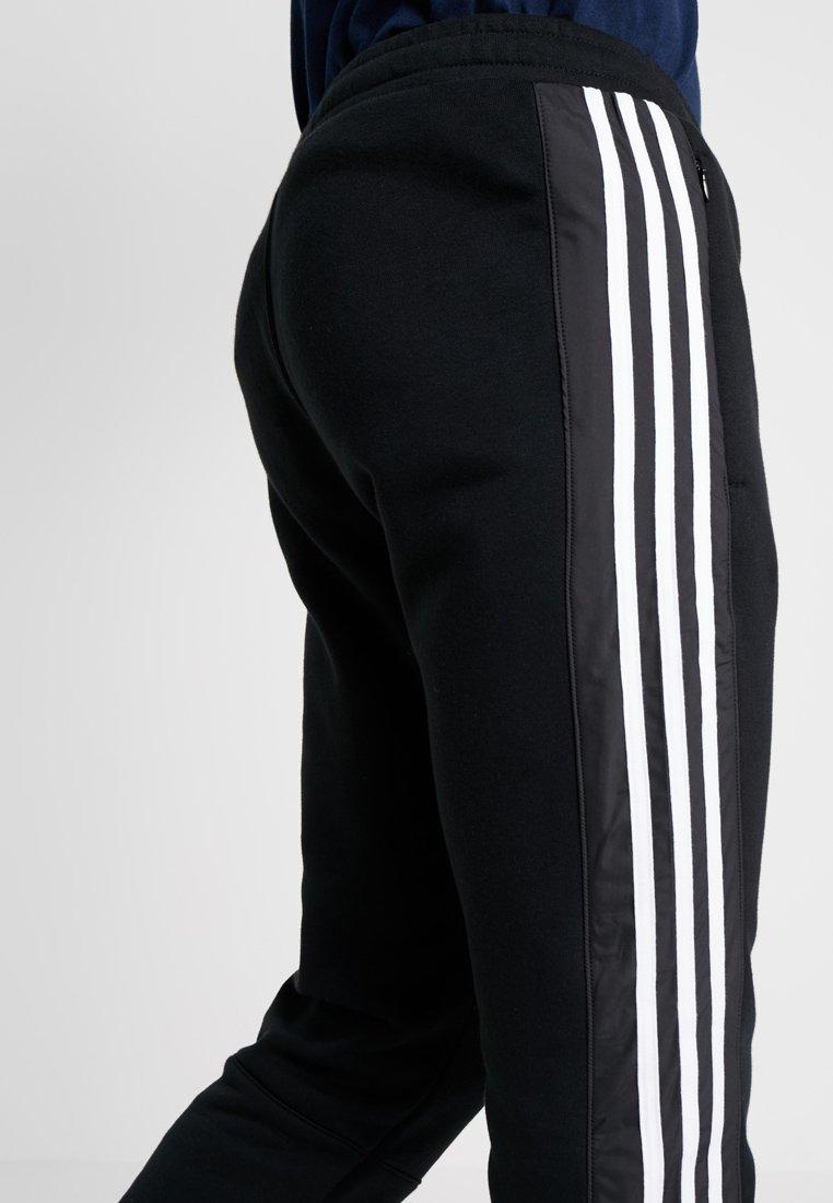 OUTLINE REGULAR TRACK PANTS Jogginghose black