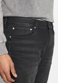 Calvin Klein Jeans - 035 STRAIGHT - Straight leg -farkut - black - 3