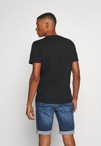 Diesel - JAKE - T-shirt con stampa - black/yellow - 2