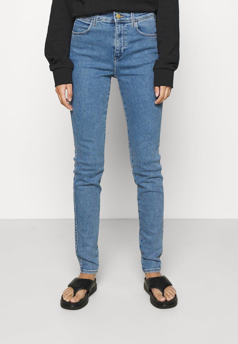 Wrangler - HIGH RISE SKINNY - Jeans Skinny Fit - static stone