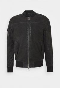 VELTE - Leather jacket - black