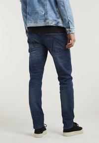 CHASIN' - CROWN OREGON - Straight leg jeans - dark blue - 1