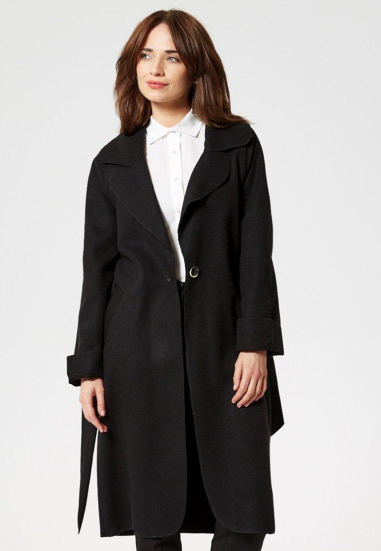 usha - Trenchcoat - black