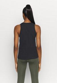 Nike Performance - DRY TANK  YOGA - Sports shirt - black - 2