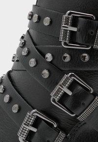 Marco Tozzi - Cowboy/biker ankle boot - black antic - 2