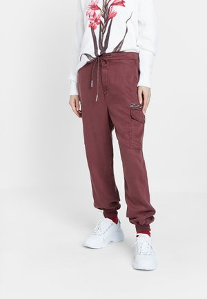 GRETA - Relaxed fit jeans - red