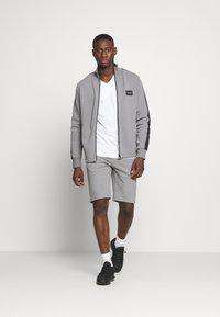Calvin Klein - V-NECK CHEST LOGO - T-paita - white - 1
