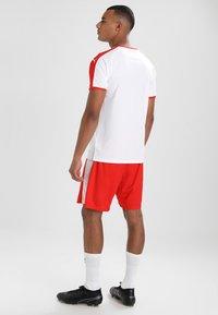 Puma - LIGA  - Sportswear - white/red - 2