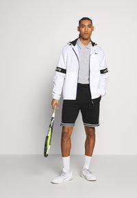 Lacoste Sport - TENNIS JACKET - Waterproof jacket - white/black - 1