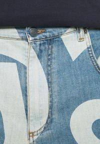 MOSCHINO - TROUSERS - Denim shorts - fantasy blue - 9