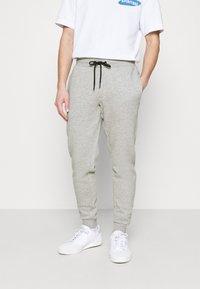 Redefined Rebel - REID PANTS - Tracksuit bottoms - light grey melange - 0