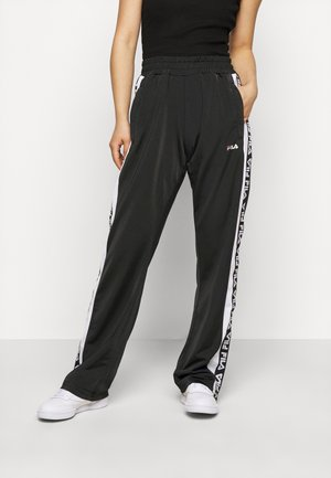 TAOTRACK PANTS OVERLENGTH - Tracksuit bottoms - black/bright white