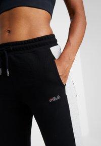 Fila - PANTS - Tracksuit bottoms - black/light grey melange - 3