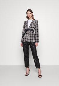 Miss Selfridge - PAPERBAG TROUSER - Trousers - black - 1