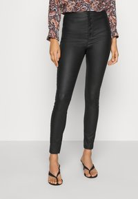 Vero Moda - VMJOY COATED  - Jeansy Skinny Fit - black - 0