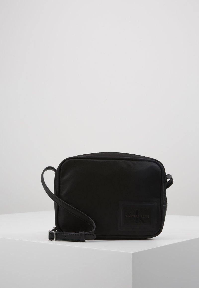 Calvin Klein Jeans - SLEEK BAG - Olkalaukku - black