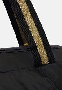 Puma - GRIP BAG 25 L - Sportovní taška - black/bright gold - 4