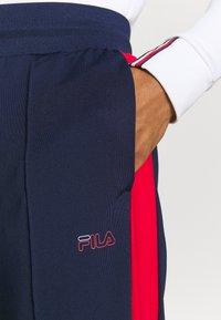 Fila - PALTI  PANTS - Teplákové kalhoty - black iris/true red/bright white - 3