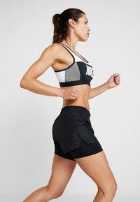 Nike Performance - 10K 2IN1 SHORT - Sports shorts - black/wolf grey - 3