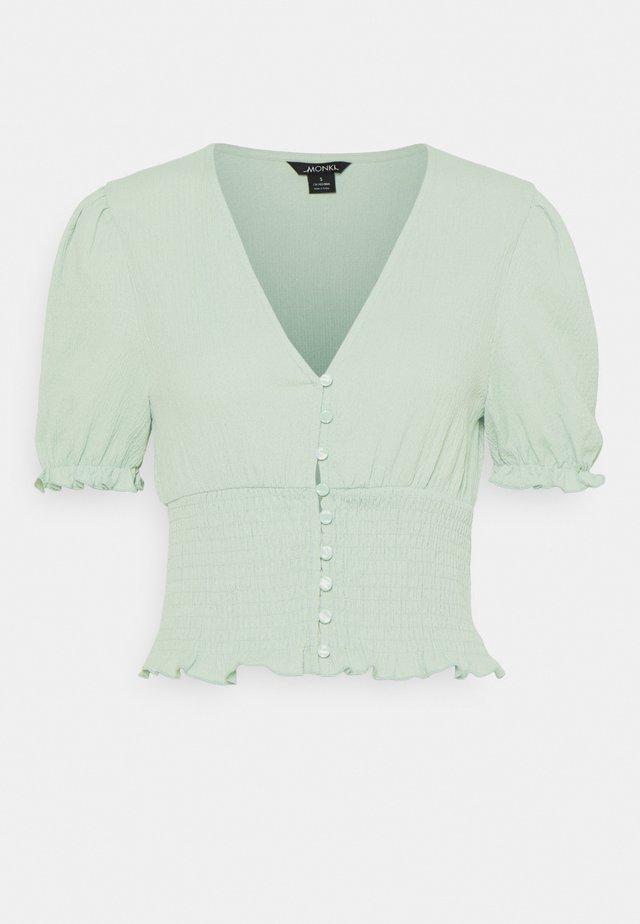 ZANJA - T-shirt med print - green dusty light