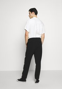 Weekday - MARD TROUSERS - Stoffhose - black - 2