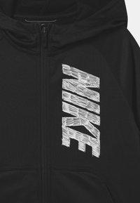 Nike Performance - THERMA HOODIE - Sportovní bunda - black/white - 2