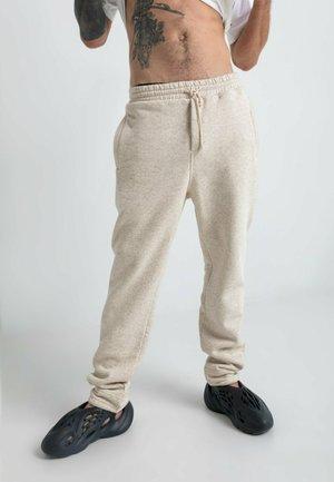 KONOPIA  - Spodnie treningowe - beige