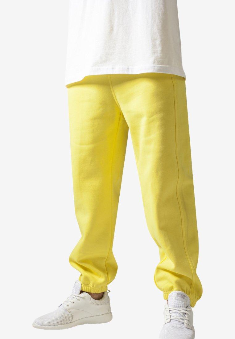Urban Classics - SWEATPANTS SP. - Tracksuit bottoms - yellow