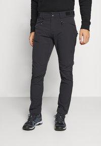 Norrøna - FALKETIND FLEX PANTS - Trousers - black - 0