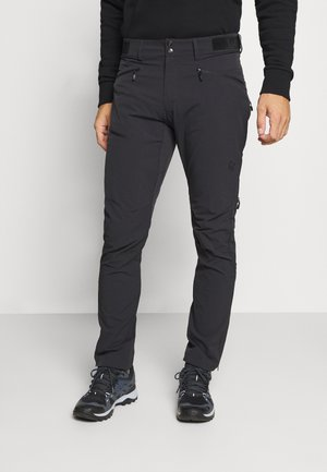 FALKETIND FLEX PANTS - Trousers - black