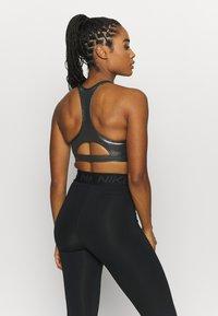Nike Performance - BRA - Medium support sports bra - black/metallic gold - 2