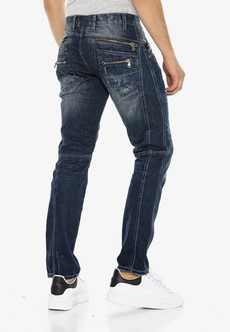 Cipo & Baxx - MIT ZIERNÄHTEN UND REISSVERSCHLÜSSEN - Straight leg jeans - donkerblauw