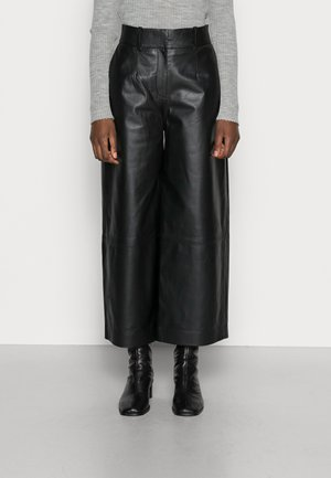 LILA - Leather trousers - black