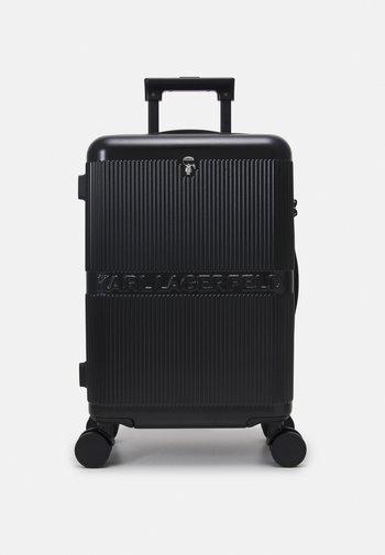 IKONIK HARDCASE TROLLEY - Wheeled suitcase - black