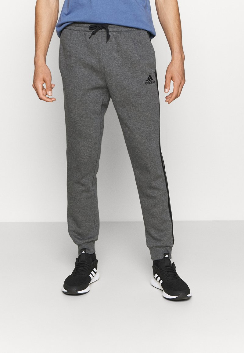 adidas Performance - 3 STRIPES  ESSENTIALS - Tracksuit bottoms - dark grey heather/black