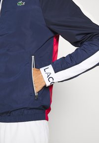 Lacoste Sport - TRACK JACKET - Träningsjacka - navy blue/ruby/white/navy blue - 4