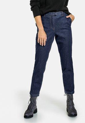 VERKÜRZT 7/8 CITYSTYLE DRY INDIGO - Slim fit jeans - dark denim
